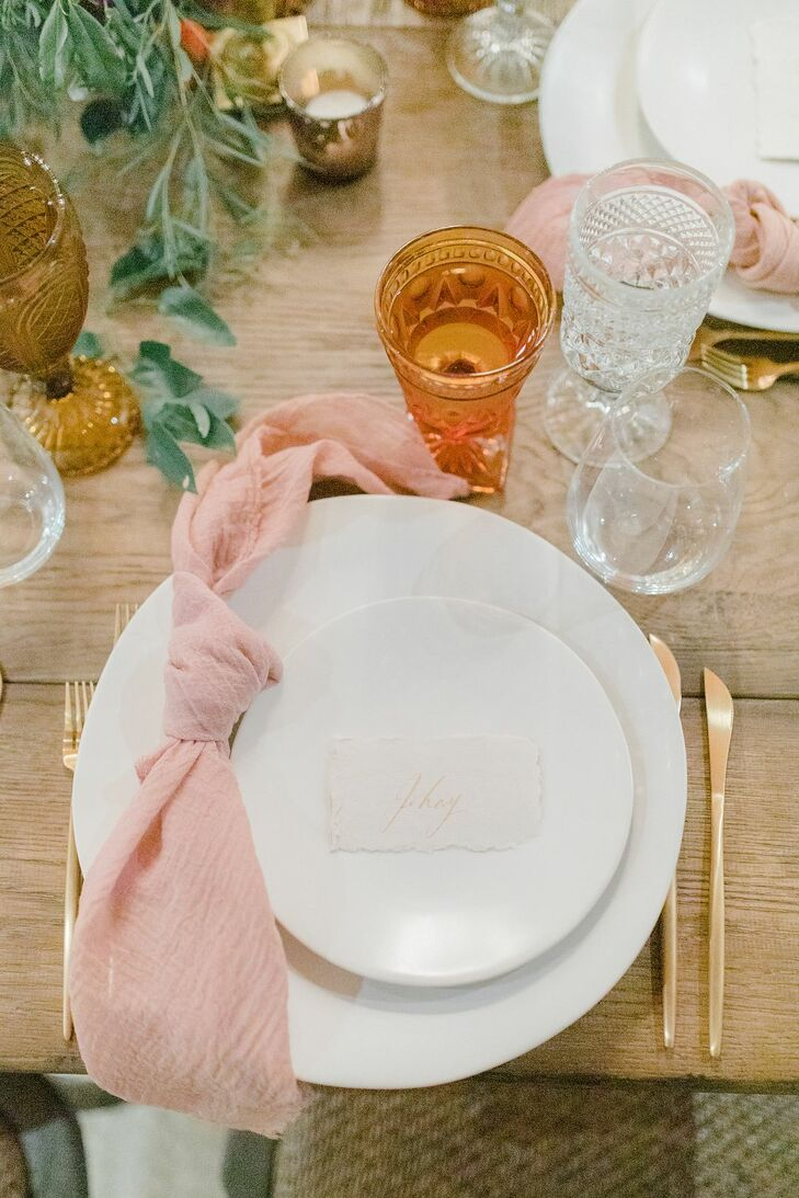 Place Setting with Blush Napkin and Gold Flatware