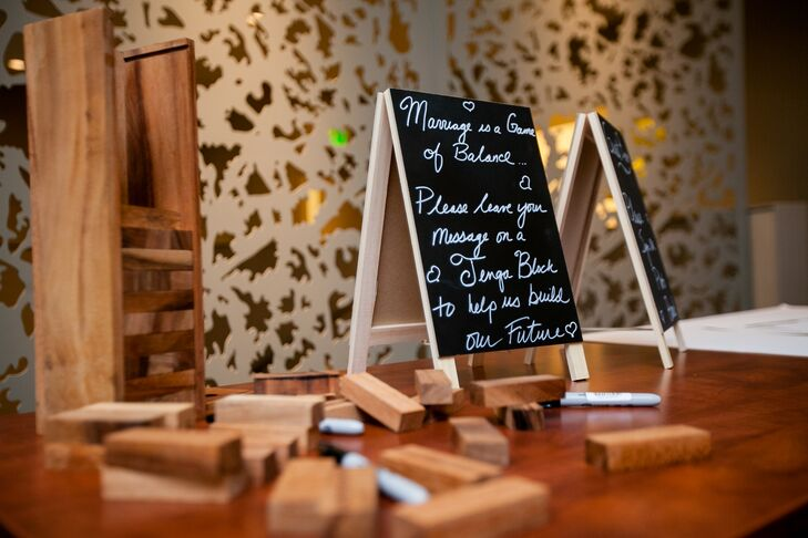 Dawn and Chad had attendees sign Jenga blocks instead of a traditional guest book. This way the couple can remember their friends and family whenever they play their favorite game.