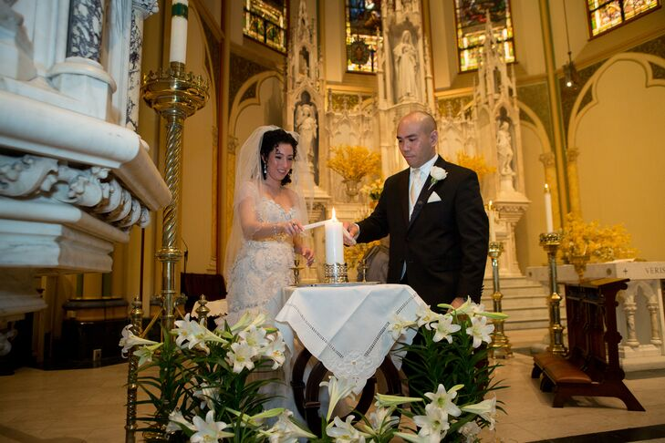 To symbolize their union, Marielle and Roderick lit a single candle, using their own individual taper candles.