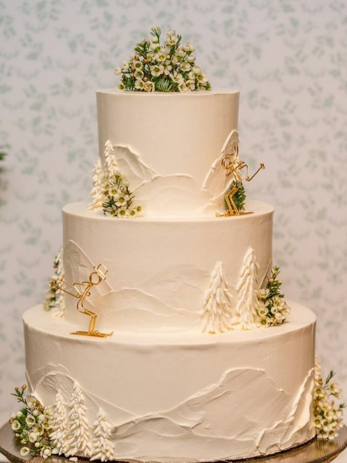 Ski-themed three-tier wedding cake