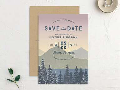 Mountain landscape with sunset background, with 'Save the Date' in bold blue type