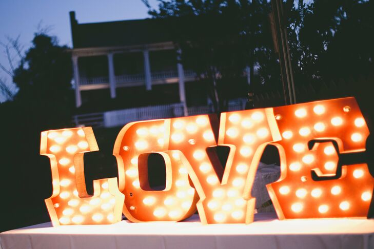 Marquee letter lights spelling out LOVE highlighted the day's theme and added a modern touch to the reception decor.