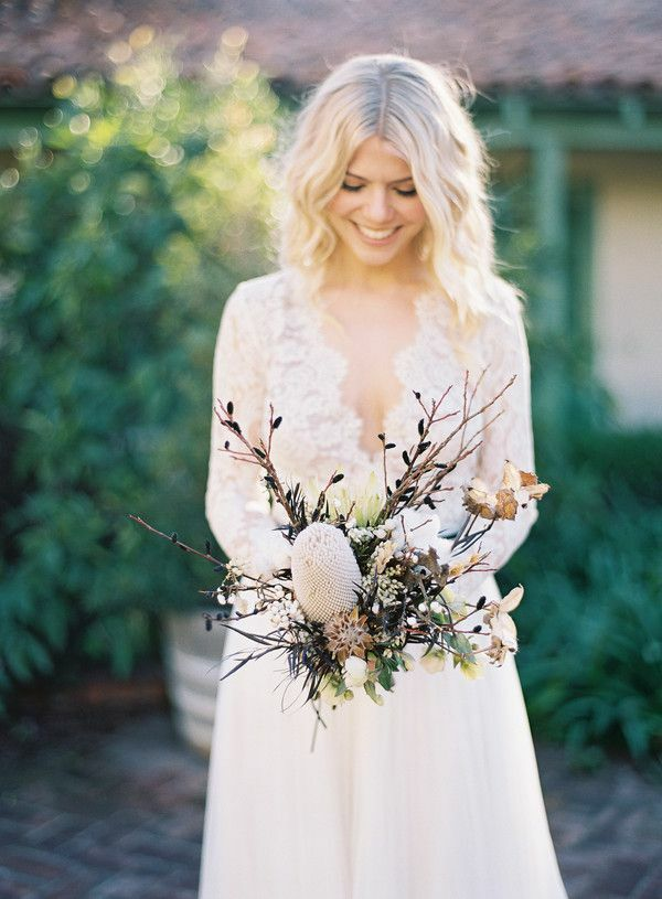 Bride holding bouquet with branches