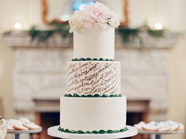 white fondant wedding cake with script detail
