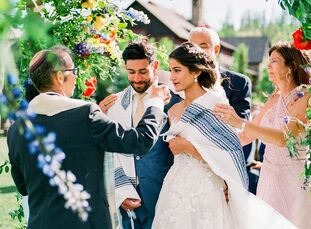 """Color, and lots of it, was the name of the game at Gaby and Jake's wedding in the mountains of Tabernash, Colorado, at Devil's Thumb Ranch. """"We wanted"""