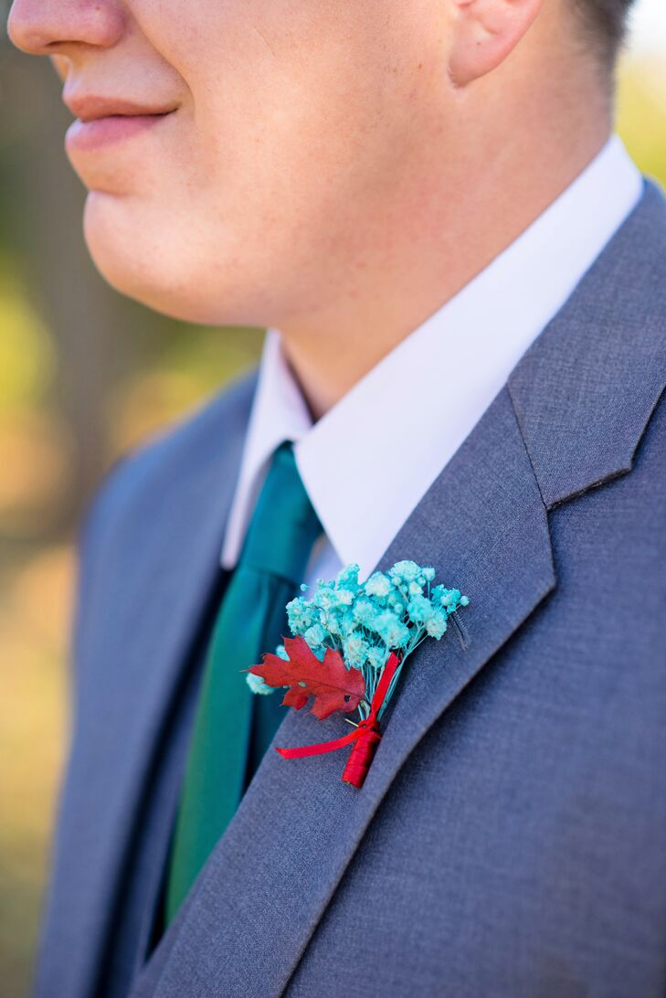 The groom and his groomsmen wore matching teal and red boutonnieres to go with their gray fashions and teal ties. The bridesmaids wore red pin-up-inspired peep-toes for a pop of color to complement the men's flowers.