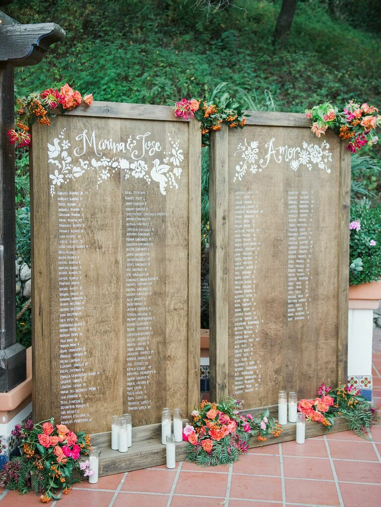 Wood seating chart with floral accents