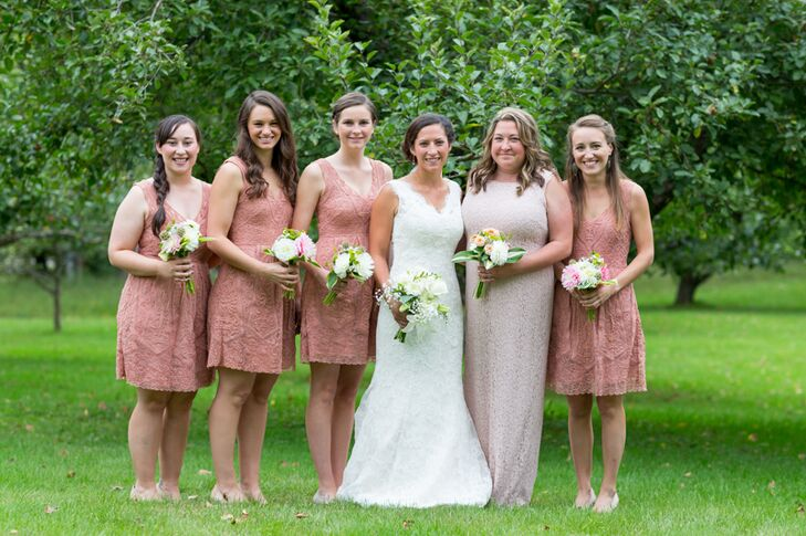 For her bridesmaids, Molly had the girls don matching lace A-line dresses from Anthropologie in a romantic shade of dusty rose, with the exception of her maid of honor, who wore a floor-length lace sheath gown in a soft blush hue. They accessorized with nude heels and sweaters in a spectrum of neutral colors.