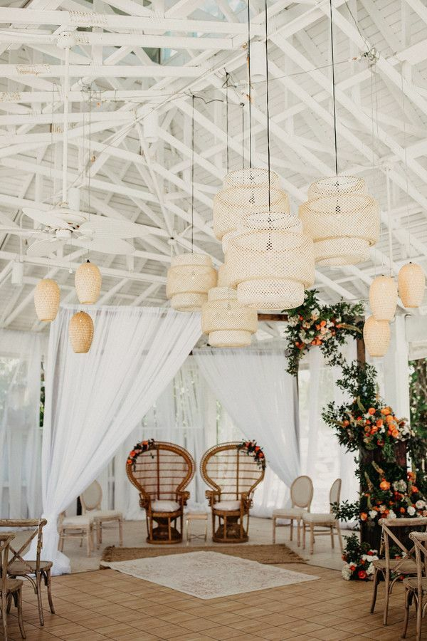 Boho mandap with woven chandeliers and peacock chairs