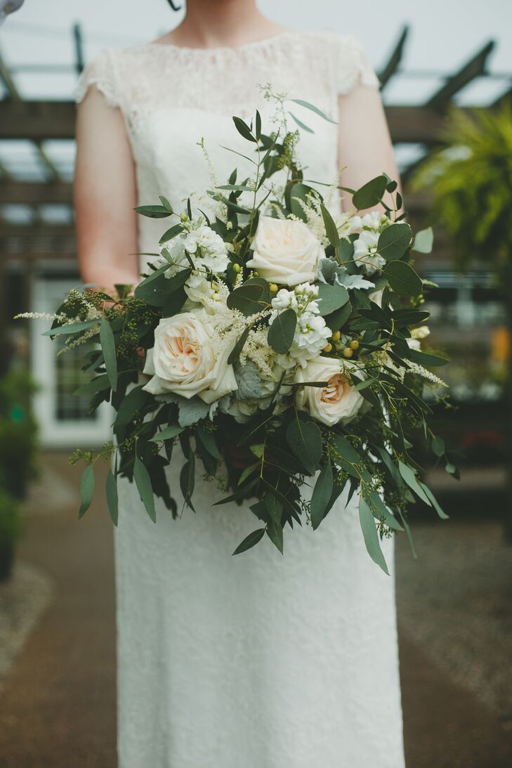 """A mix of ivory and white flowers, cascading greens and small berries made up Natalie's lush bouquet. """"I never thought I cared about flowers until I saw mine,"""" she says. """"Money well spent."""""""