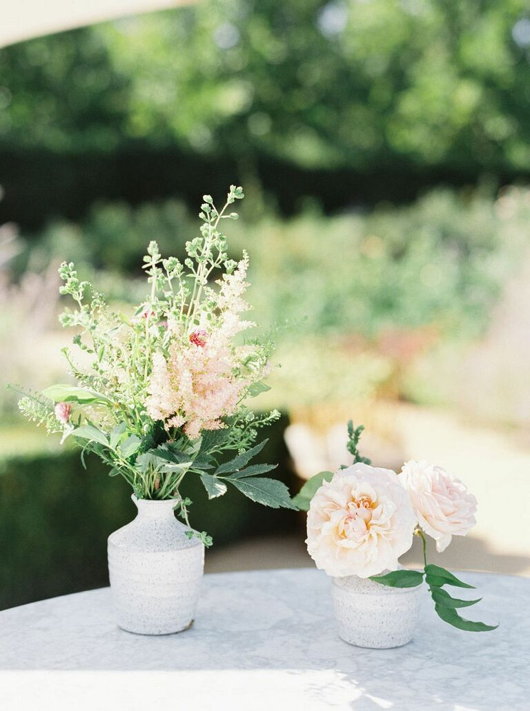 Petite gray bud vases with greenery and pink flowers