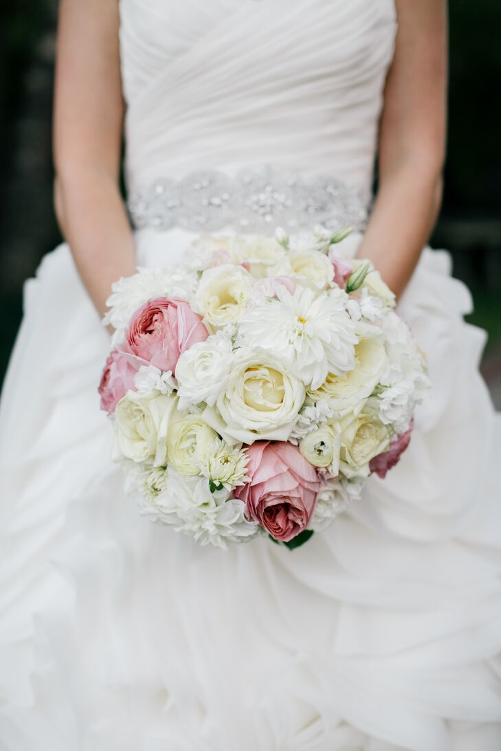 Joelle carried a romantic pink and white bouquet with peonies, roses, ranunculus and dahlias.