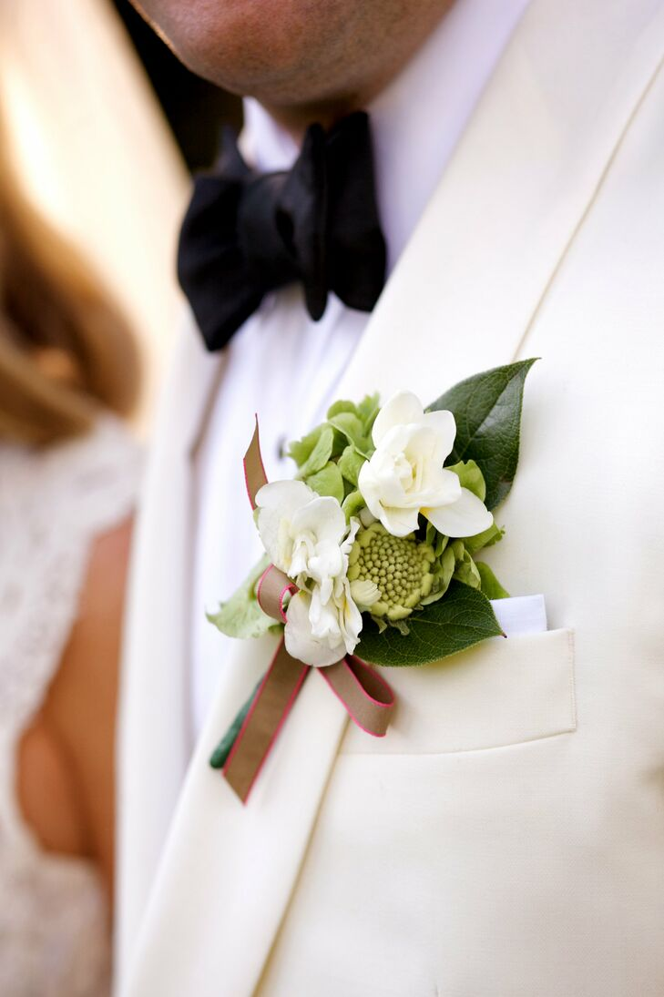 Will wore a modern boutonniere of hypericum, hydrangea, freesia and a poppy pod