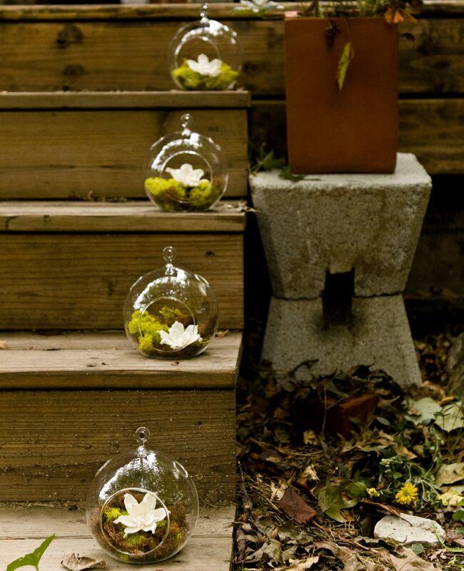 Hanging glass globe wedding decor: Spark Photography / TheKnot.com