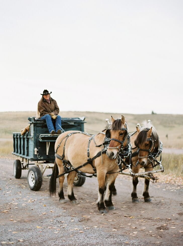 After the ceremony, which took place on a cliff with breathtaking views of the Blackfoot River, the newlyweds and their guests went back to the ranch reception in true Montana fashion—in a horse-drawn wagon.