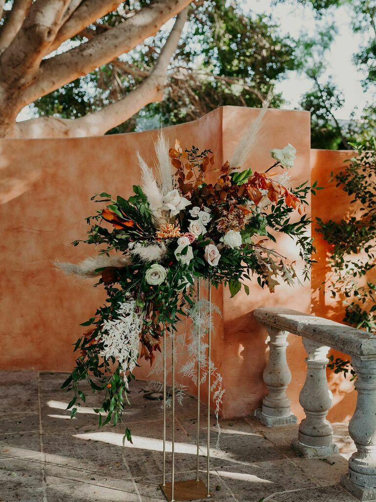Warm neutral floral arrangement at wedding