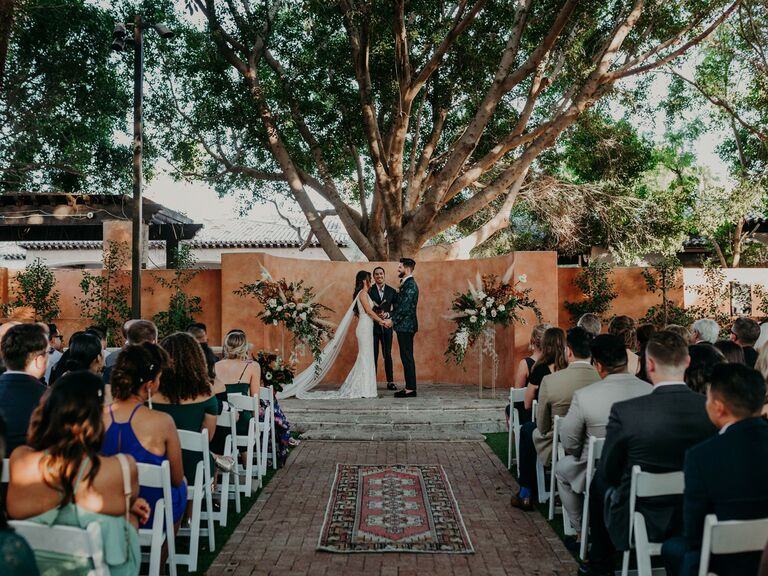 how to honor loved one at wedding moment of silence bride and groom holding hands while guests watch