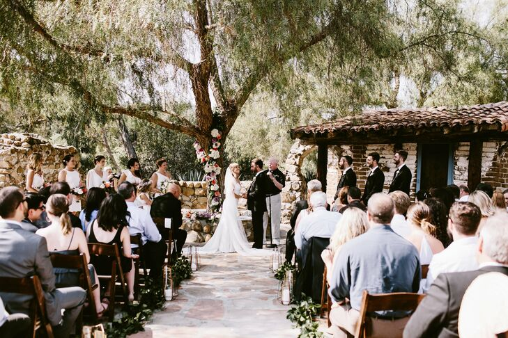 During their outdoor ceremony at Leo Carrillo Ranch in Carlsbad, California, Mira and Nate said their vows while holding a traditional Ukrainian rushnyk that was handmade by Mira's mother.