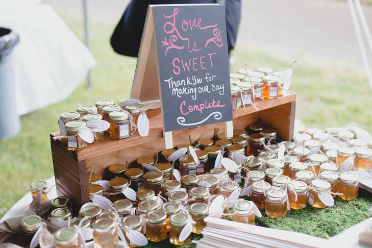 """Molly and Mark had special DIY wedding favors: """"My grandfather is a beekeeper and we bottled some of his honey in little jam jars and gave it with a gift tag that read 'You're so sweet for coming.' """""""
