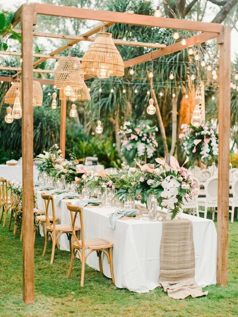 Tropical wedding reception with woven chandelier