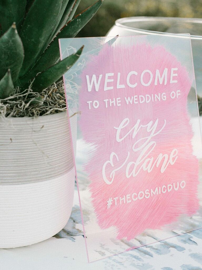 Acrylic wedding hashtag sign with pink watercolor base and white font
