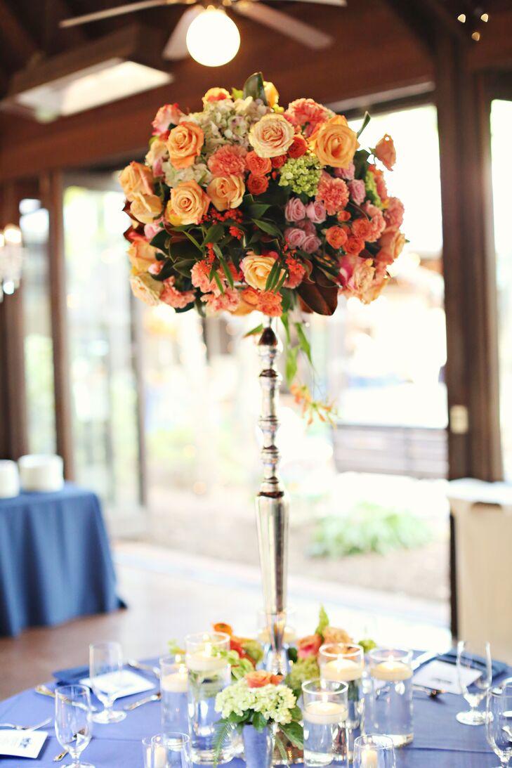 Lush Silver Pedestal Orange Flower Arrangements