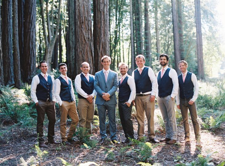 The groomsmen wore brown slacks and navy vests with white collared shirts, which greatly differed from Shiloh's light gray suit. But they all matched with light pink ties.