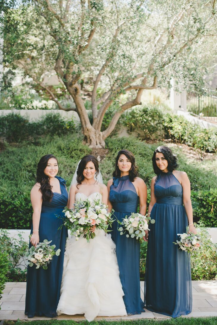 Classic was the underlying aesthetic for the wedding party's attire, and the elegant Amsale bridesmaid gowns certainly filled the bill. Two of Ivette's bridesmaids donned chiffon A-line styles with illusion halter necklines, while her maid of honor stepped out in a one-shoulder design with an empire waist.