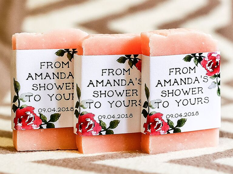 Soap bars wrapped in personalized labels with pink florals in corners