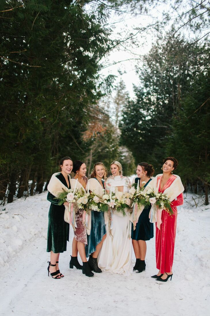 Bridal Party With Colorful Dresses and Shawls in the Snow