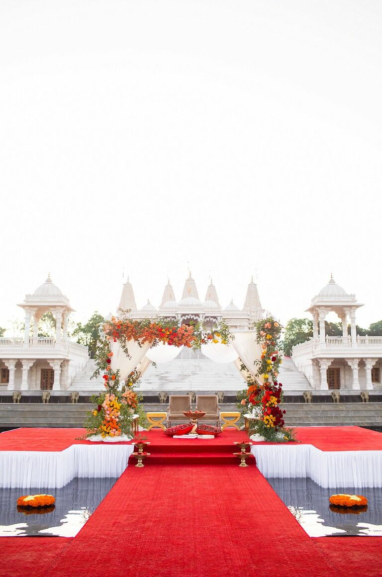 Glam mandap atop red stage