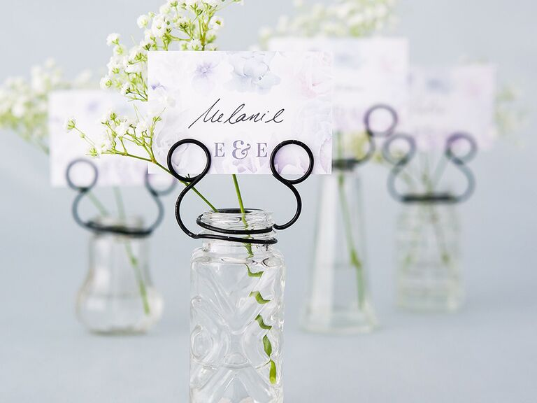 Simple pressed glass vases with blare wire card holders