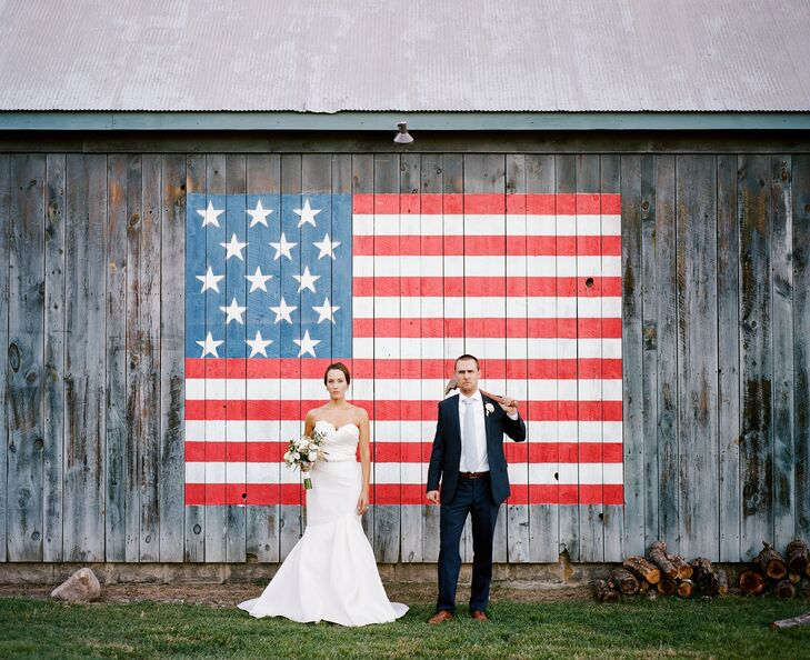 """The newlyweds posed for a portrait in front of an old barn painted with the American flag, which had a similar aesthetic to Grant Wood's iconic """"American Gothic"""" painting."""