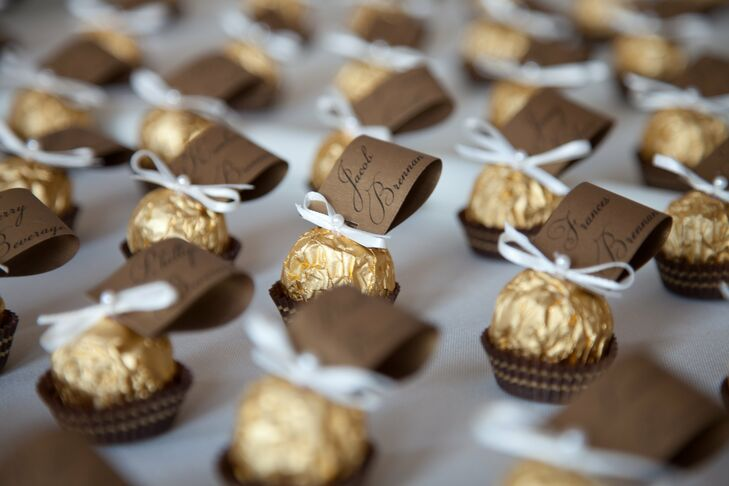 Ferrero Rocher chocolates were used to hold the escort cards. These edible treats were decorated with an ivory ribbon tie and topped with a pearl detail.