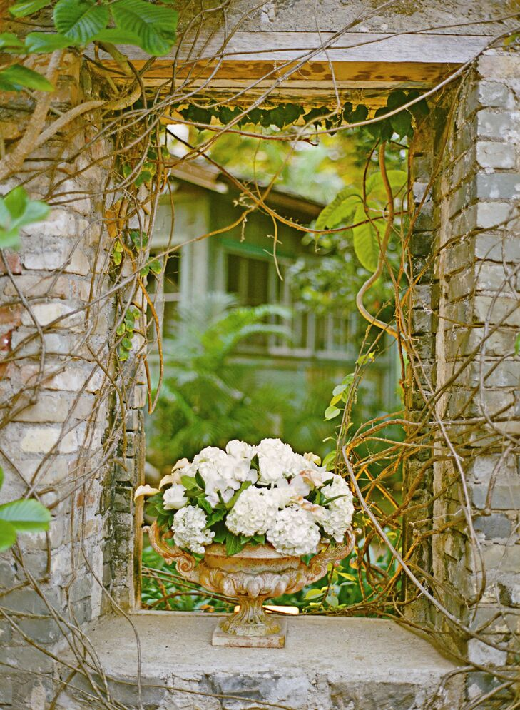 Since their venue was full of interesting natural decor, Mackenzie and Tim only added a few, simple elements, like this rustic-looking urn filled with hydrangeas and cymbinium orchids.