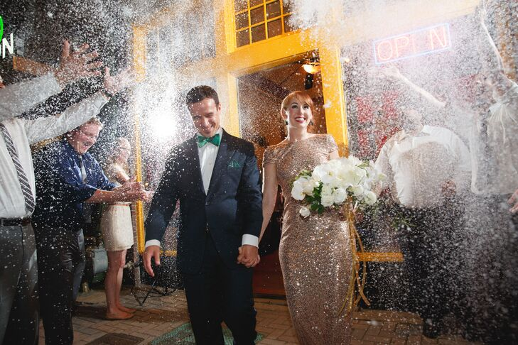 Angela and Ben requested that their guests would wear white or gray tones since they would be wearing bright colors. Their guests showered them with ecofetti, a snow-like dust, for their grand exit.
