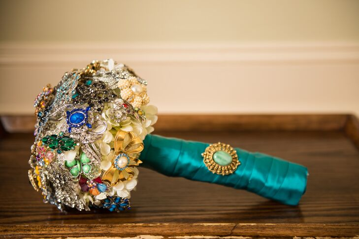 Kasi carried a teal-wrapped crystal encrusted bouquet and made all of her flower arrangements before the wedding with help from friends and family.