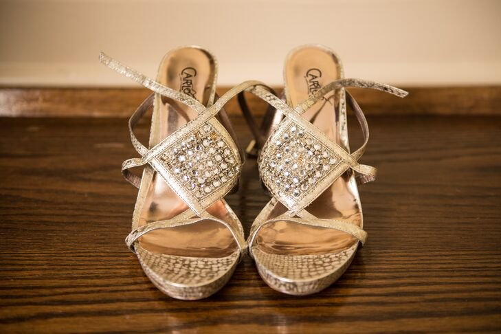 Keeping in mind that she was having a summer farm wedding, Kasi found a pair of comfortable metallic sandals to wear with her lace gown.