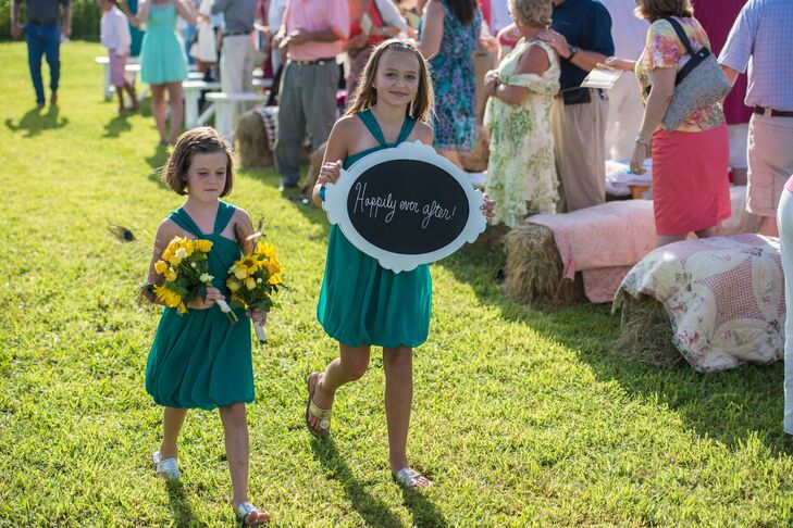 The ceremony took place in a horse pen ringed with sunflowers. They chose July for their wedding specifically so that sunflowers would be in season.