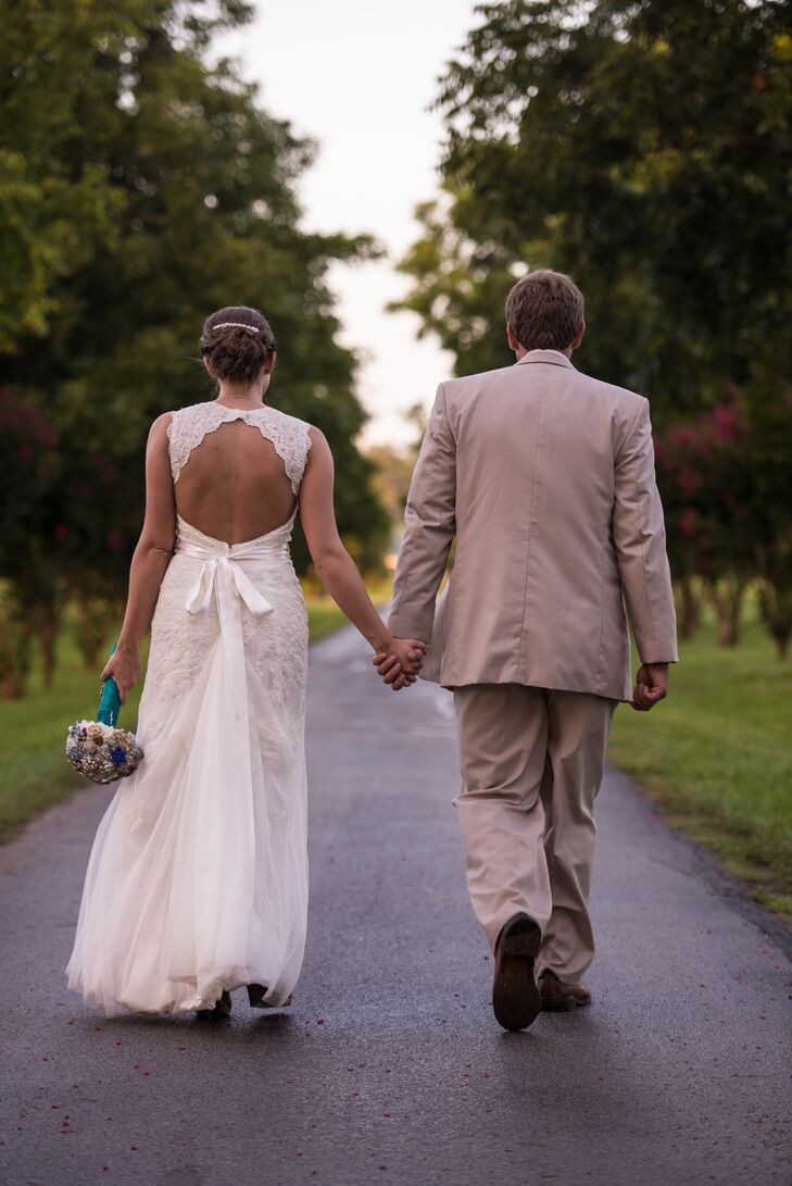 """Kasey wore her hair up to complement her lace gown's cut-out detail. """" I knew my wedding would be outside and in the summer so I found a simple lace dress with a keyhole back,"""" says Kasi."""