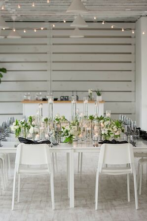 Modern Reception Table With White Chairs, Taper Candles and Greenery