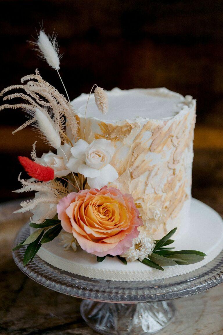 Textured beige wedding cake with flower decorations