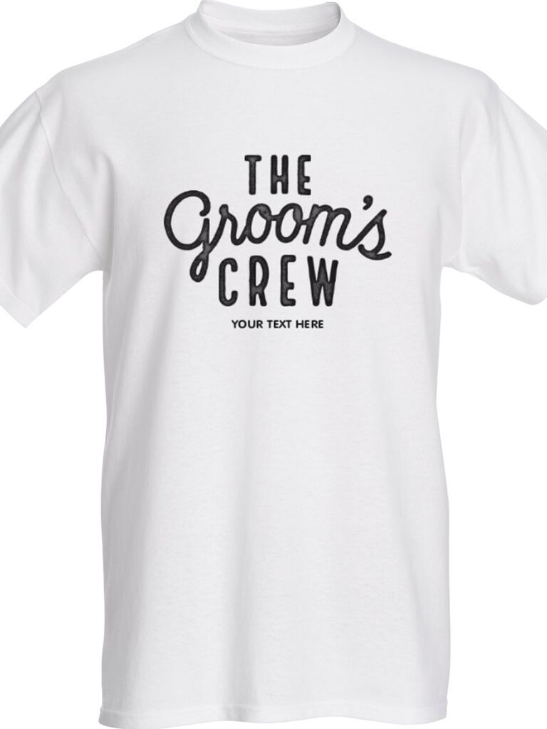 'The groom's crew' in black type on white tee