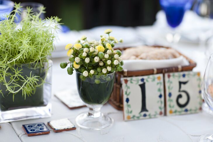 Small arrangements of berries and flowers topped the tables along with Talavera-tile table numbers.