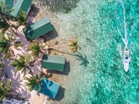 Tobacco Caye aerial barrier reef with boat in Belize, Central America