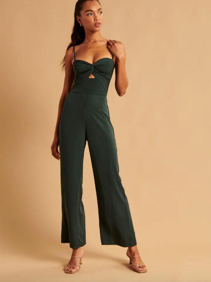 Dark green twist-front fall wedding guest jumpsuit
