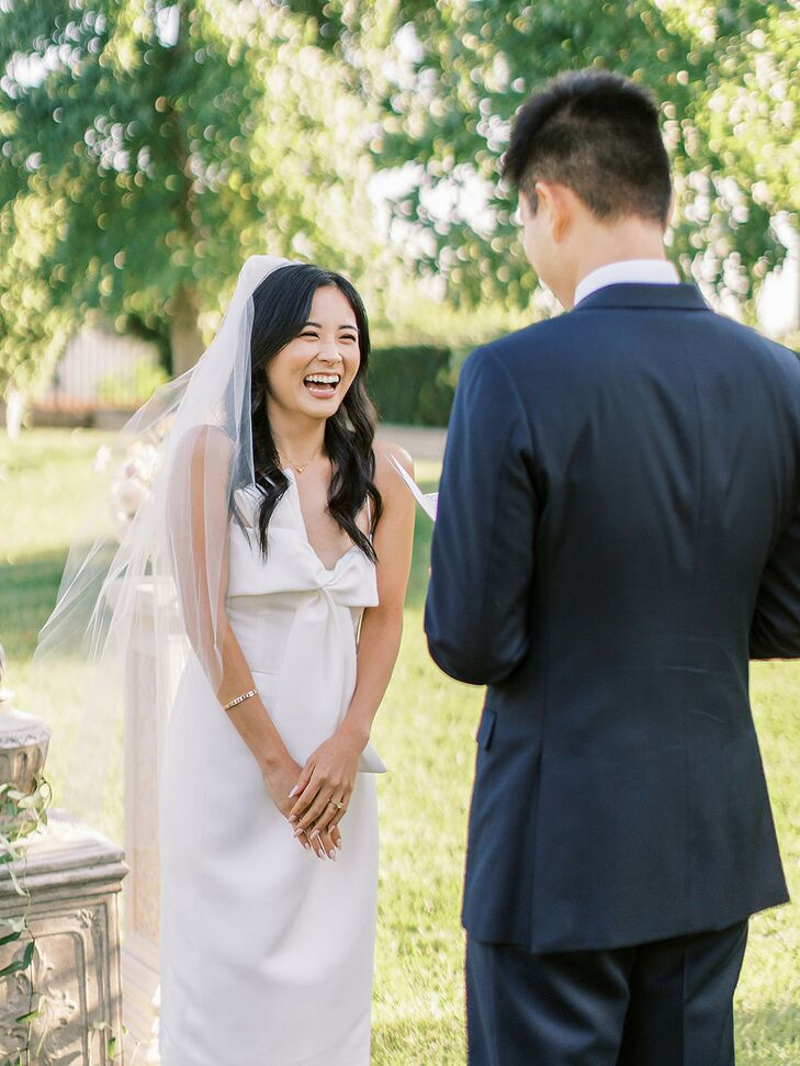 Couple Exchanging Vows During Backyard Minimony