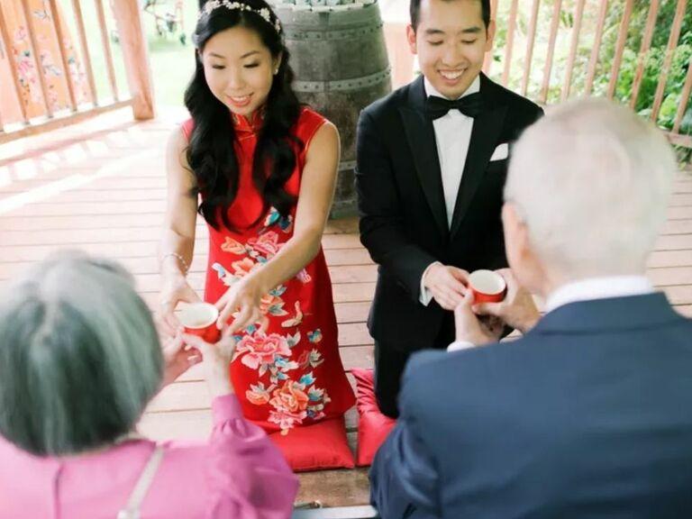 Couple serving tea to elders