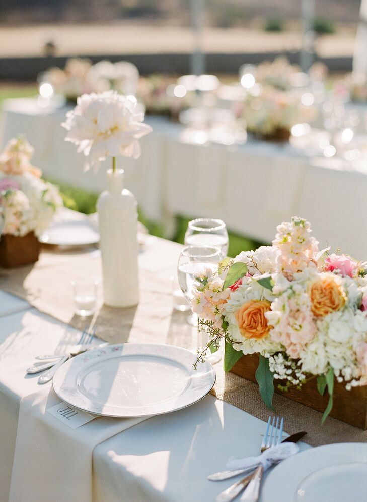 Peach, pink and ivory roses, hydrangeas, stock, peonies and baby's breath were arranged in wooden planters that Jamie and Gregger made themselves.