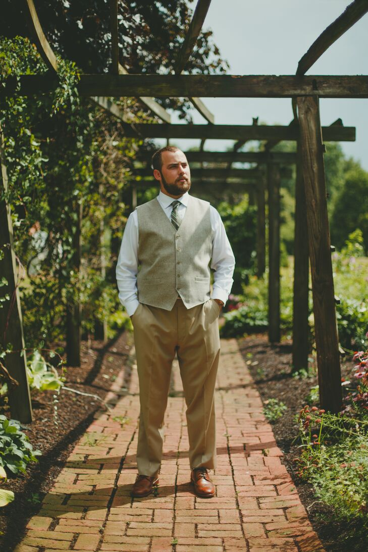 """Michael wore tan pants, a white button-down shirt, a wool vest, and a green paisley tie. The groomsmen wore the same outfit with tan ties. """"No jackets for the groom's party,"""" Natalie says."""